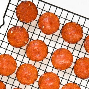 crispy pepperoni chips on a wire rack