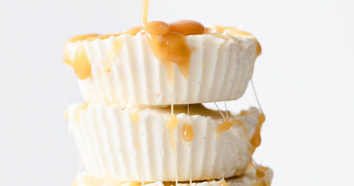 keto cheesecake fat bombs stacked on top of another topped with caramel sauce