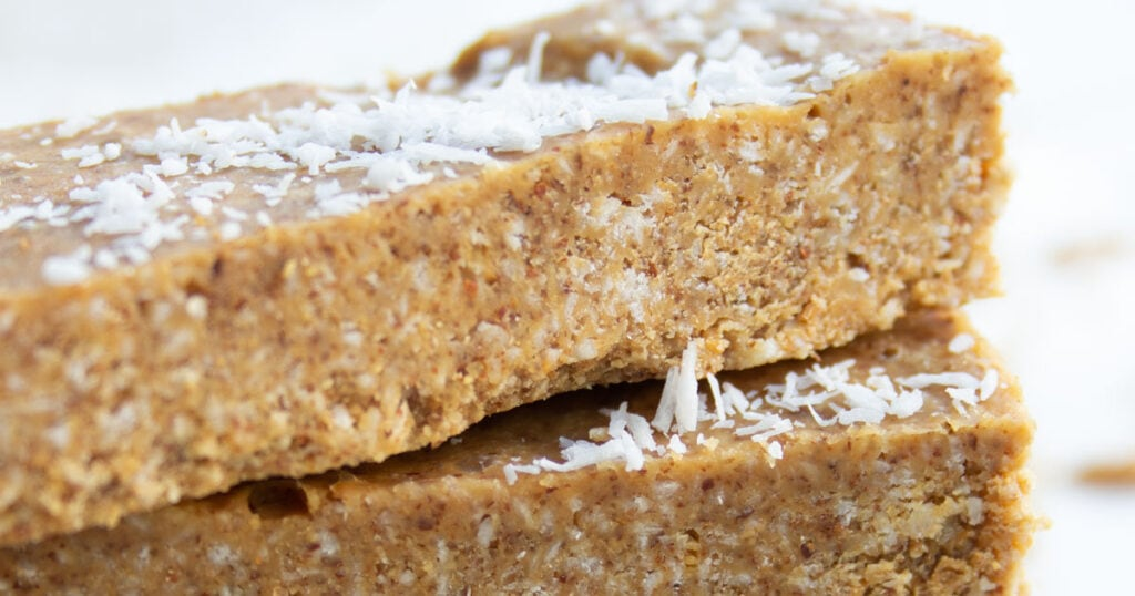 coconut almond butter bars stacked on top of each other