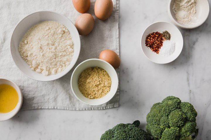 broccoli, eggs and other ingredients in bowls