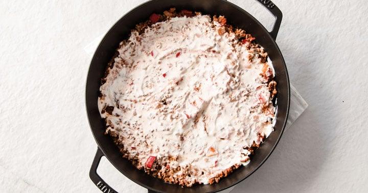 sour cream on a beef casserole dish