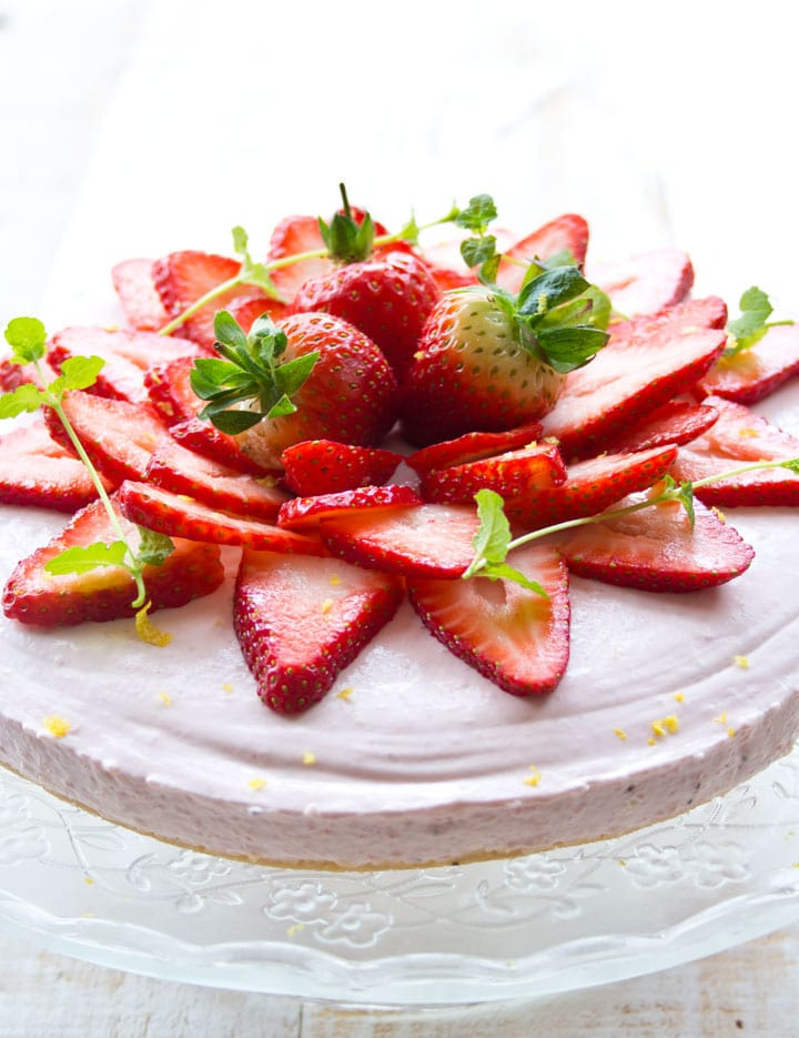 A sugar free cheesecake decorated with strawberries