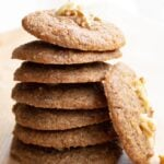 a stack of healthy banana cookies and one cookie leaning against the stack