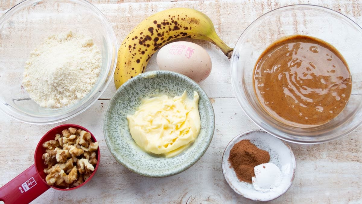 butter, almond flour, banana, egg and other ingredients for banana cookies