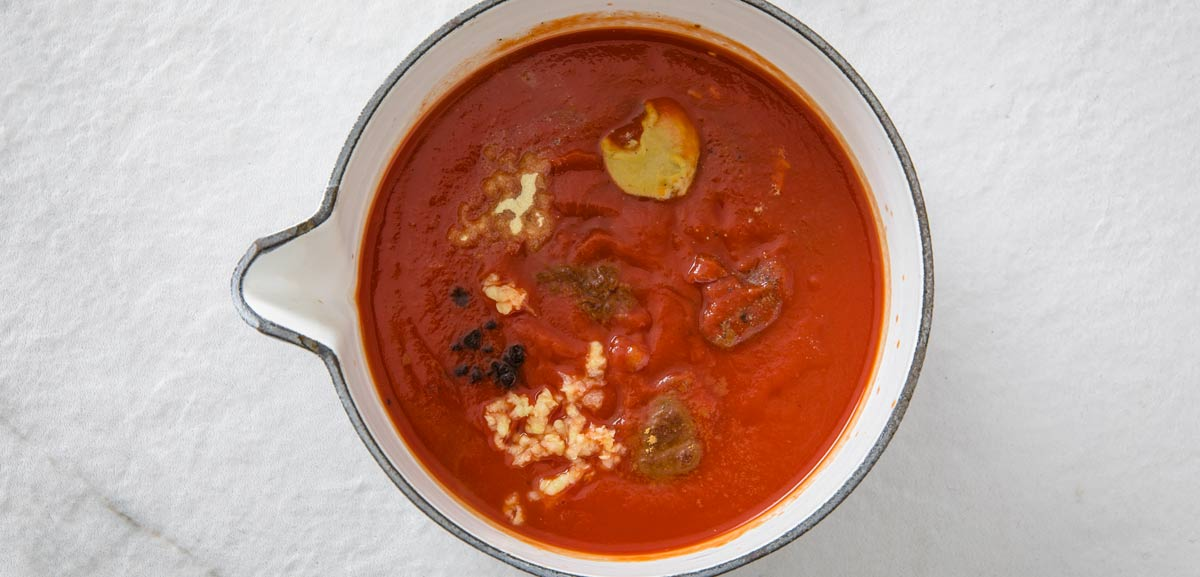 tomato puree and spices in a pot