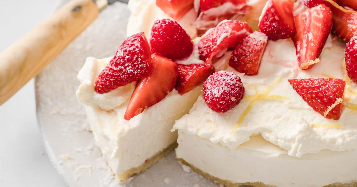 a slice of low carb cheesecake topped with strawberries and raspberries