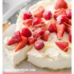 a no bake sugar free cheesecake topped with strawberries and raspberries