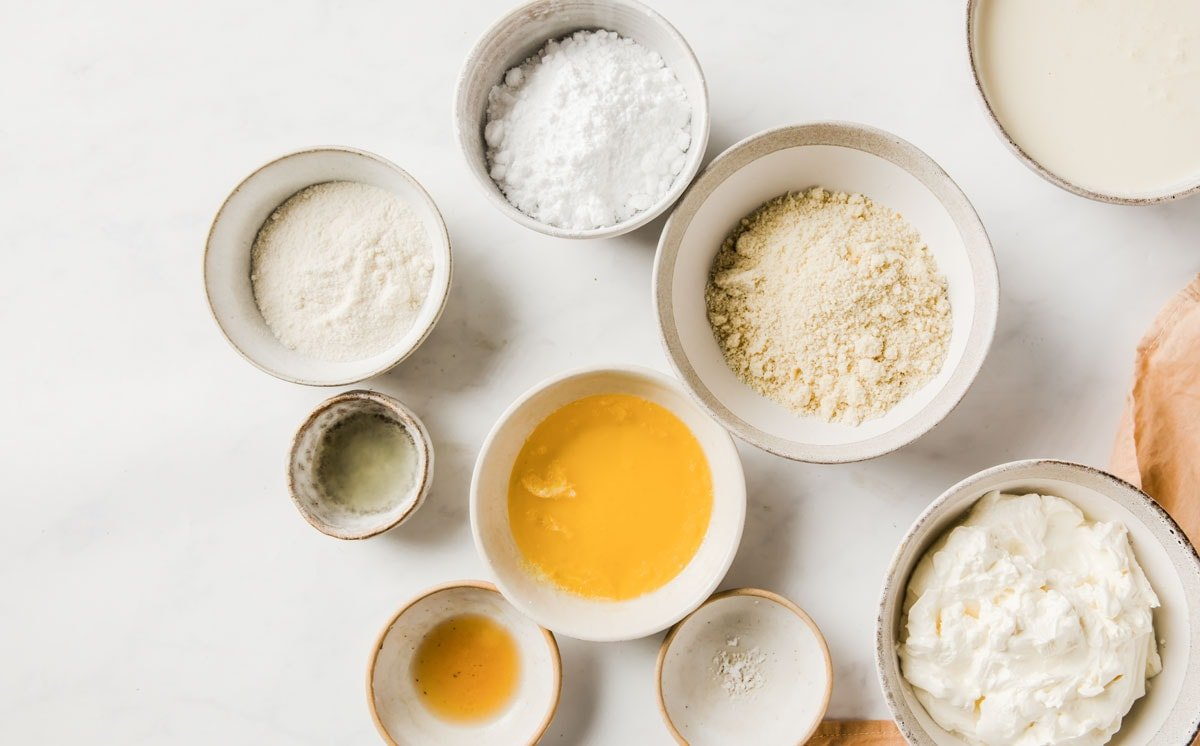 measured ingredients for sugar free cheesecake in separate bowls