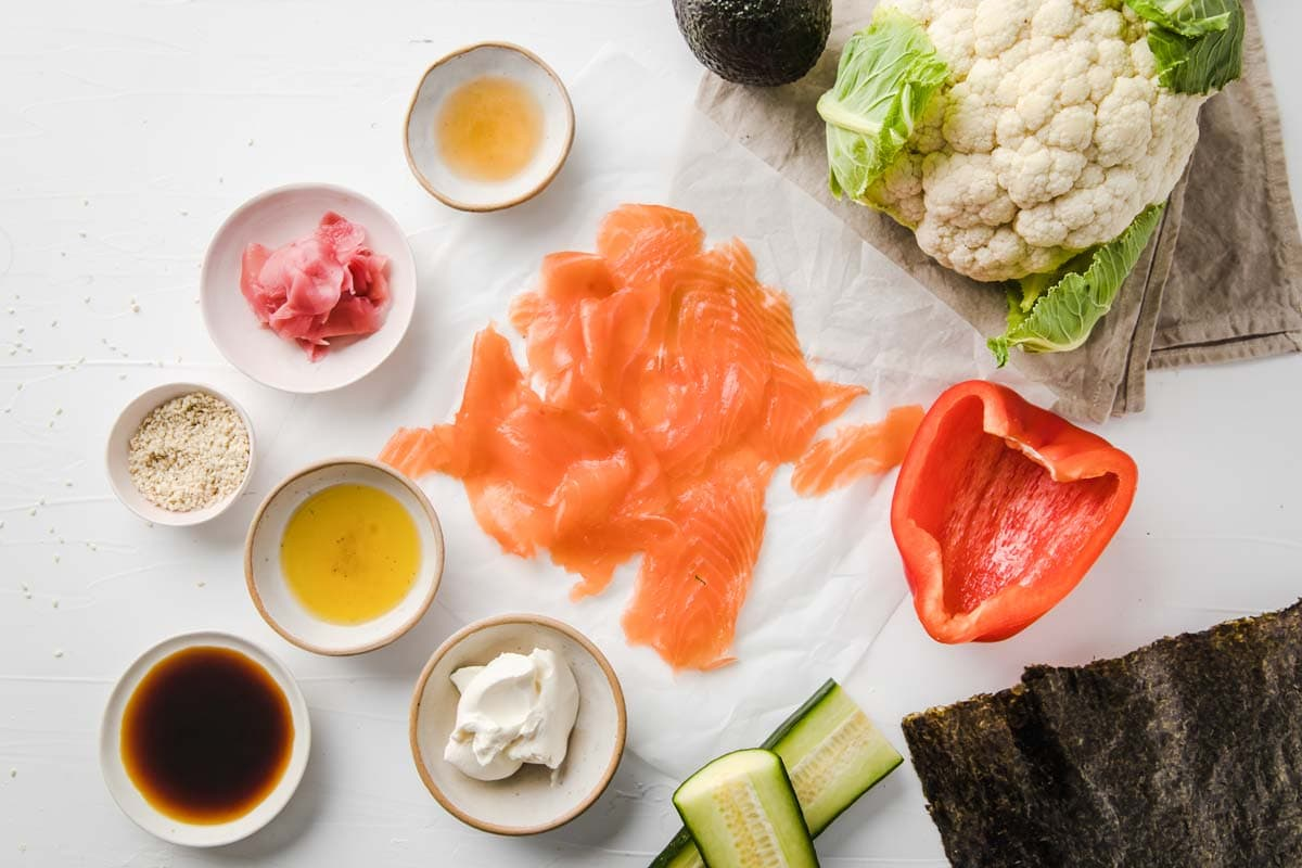 all ingredients for keto sushi measured out, from smoked salmon to cauliflower