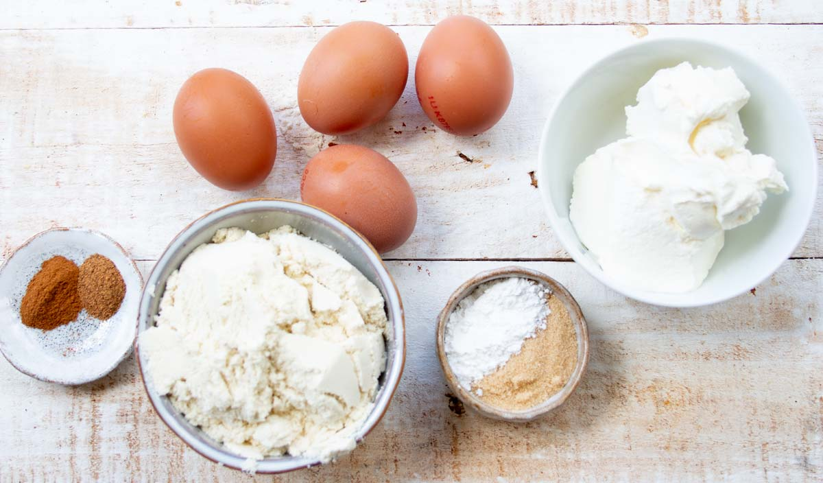 eggs, coconut flour, cream cheese, butter and other ingredients in bowls