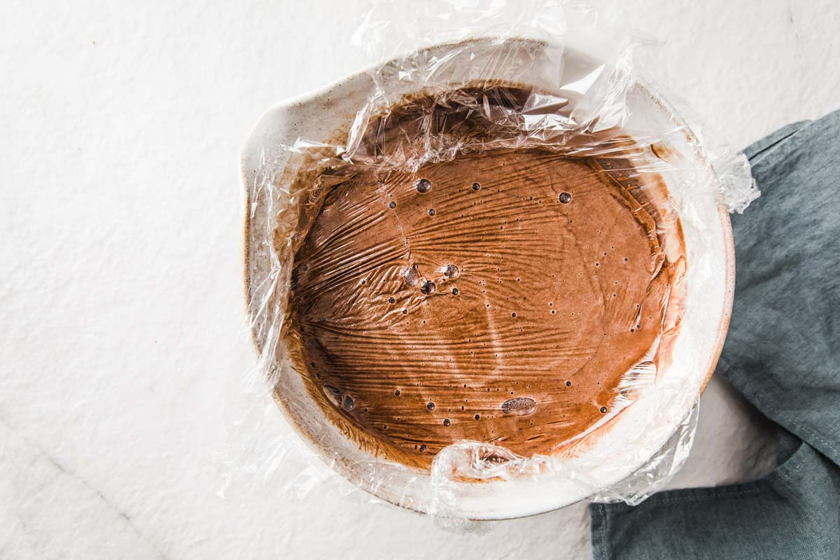 covering ice cream mix in a bowl with cling film