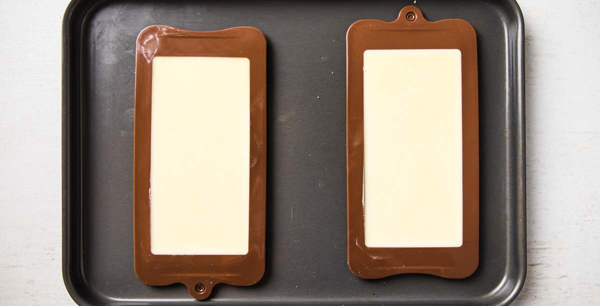 melted white chocolate in silicone moulds