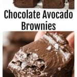 closeup of a hand holding an avocado brownie with chocolate avocado frosting and brownie squares on parchment paper
