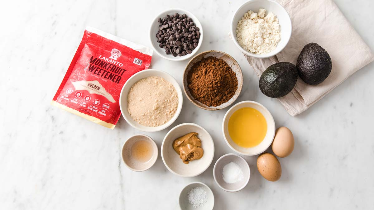 measured out ingredients for brownies in individual bowls