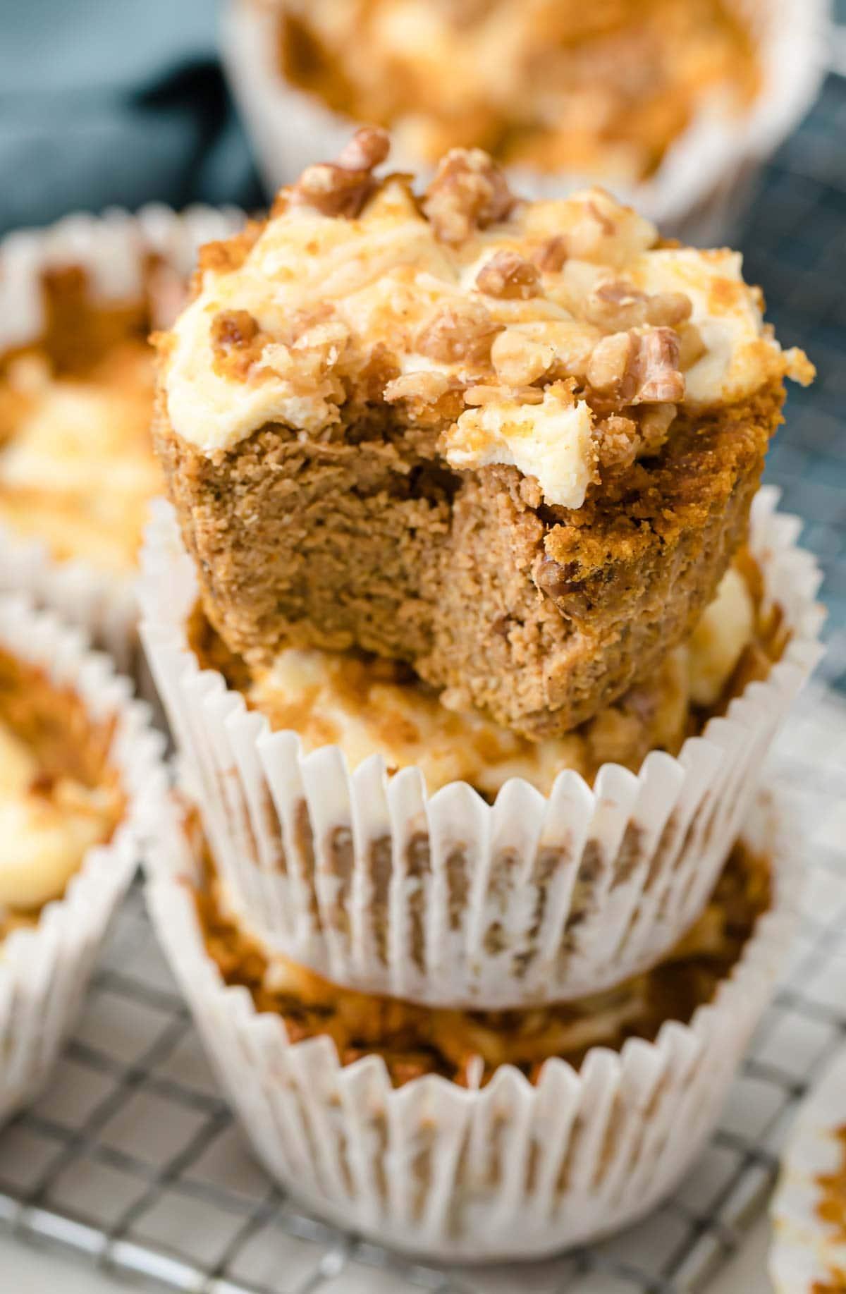a stack of pumpkin cheesecake muffins