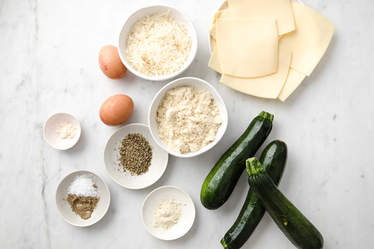 measured ingredients for zucchini grilled cheese in bowls