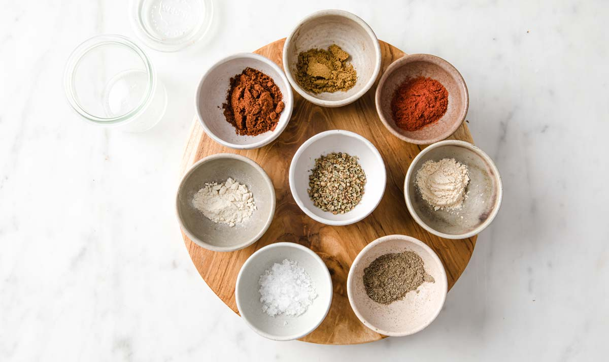 spices in bowls and a glass jar