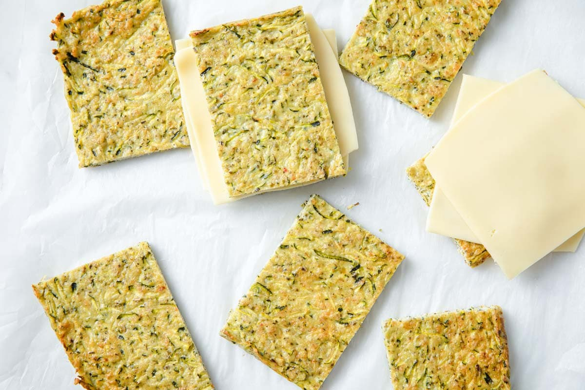 "zucchini ""bread"" sliced with cheese slices"