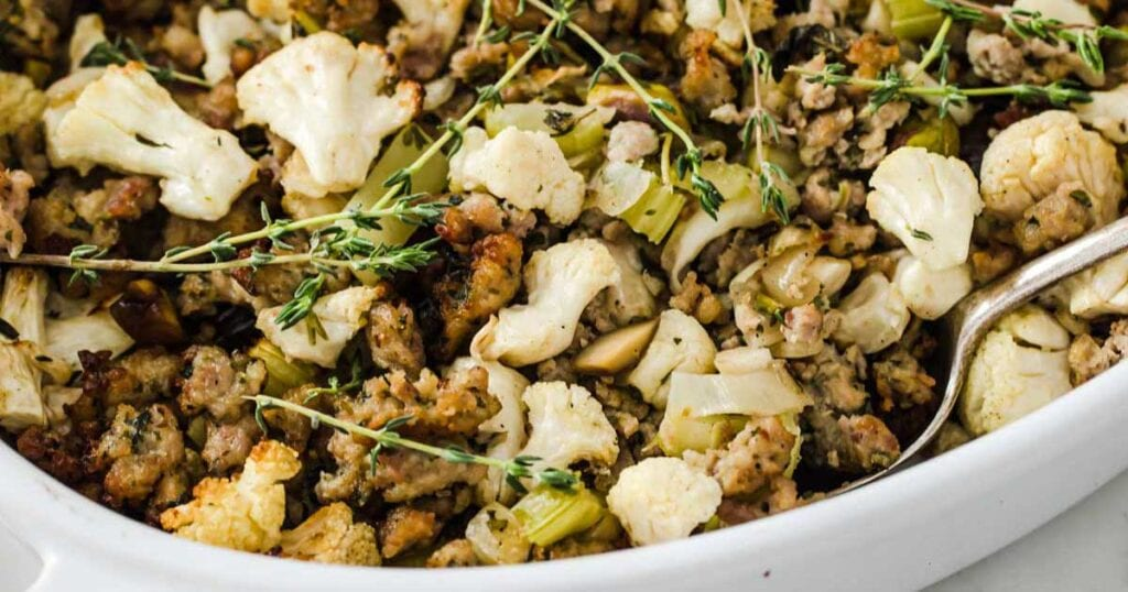 low carb stuffing with sausage, cauliflower and topped with fresh herbs