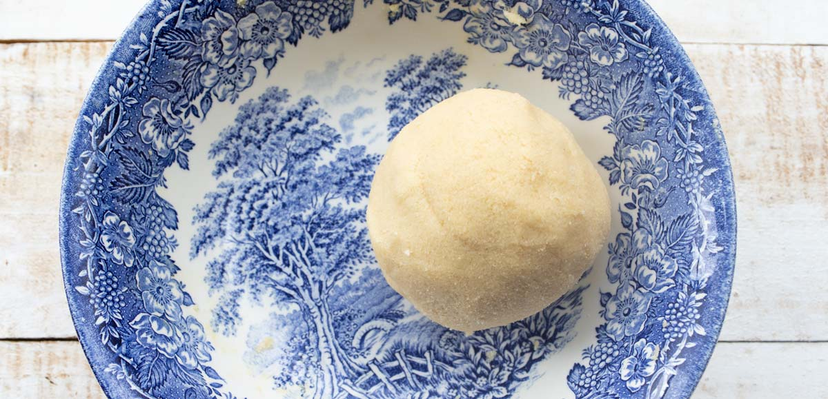 a ball of dough in a bowl