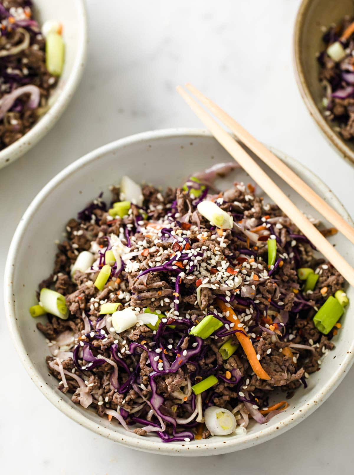 asian ground beef and cabbage aka keto egg roll in a bowl with chopsticks
