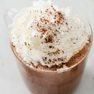 sugar free hot chocolate in a glass topped with whipped cream