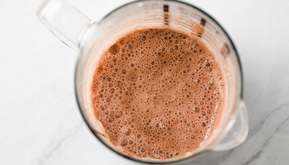frothy chocolate milk in a jug