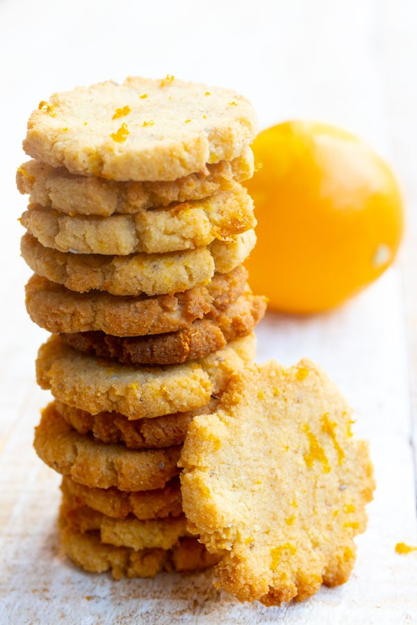 a stack of coconut orange cookies