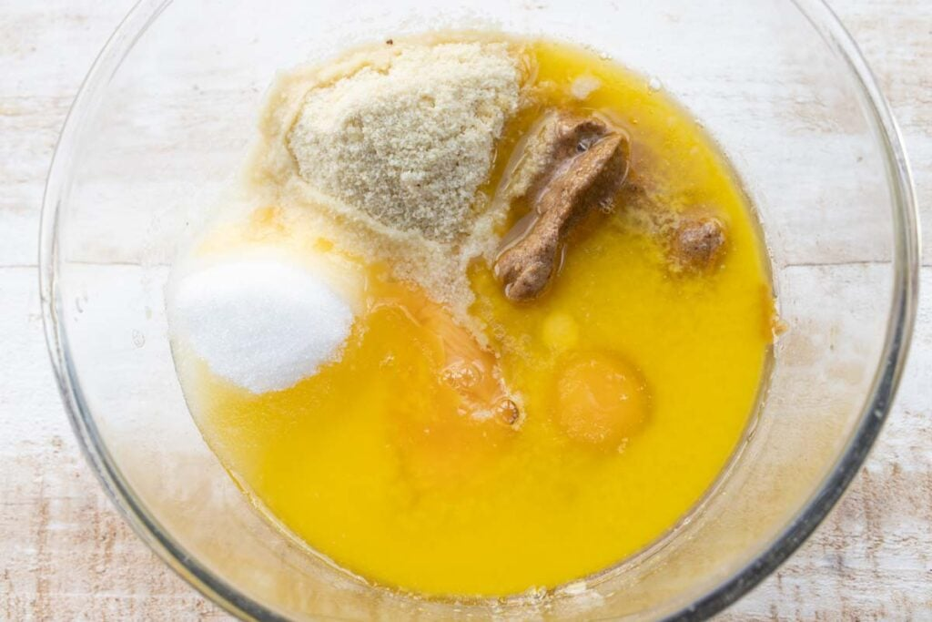keto blondie ingredients in a bowl - peanut butter, almond flour, butter, egg, sweetener