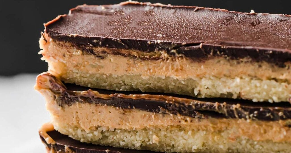 two keto peanut butter chocolate bars stacked on top of each other