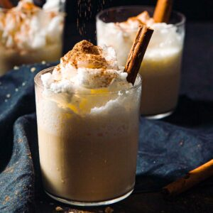 3 glasses with keto eggnog decorated with a cinnamon stick