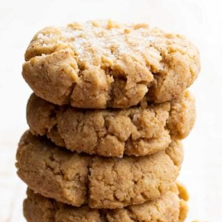 a stack of almond flour peanut butter cookies topped with sea salt