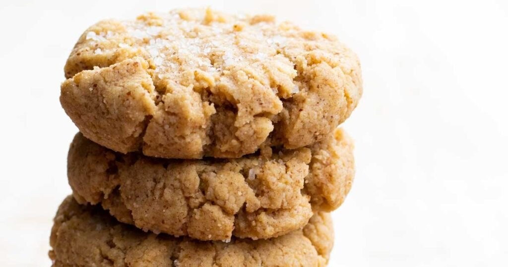 stackd peanut butter cookies topped with sea salt