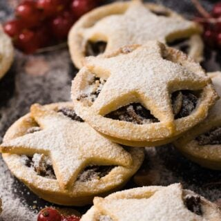stacked keto mince pies dusted with powdered sweetener