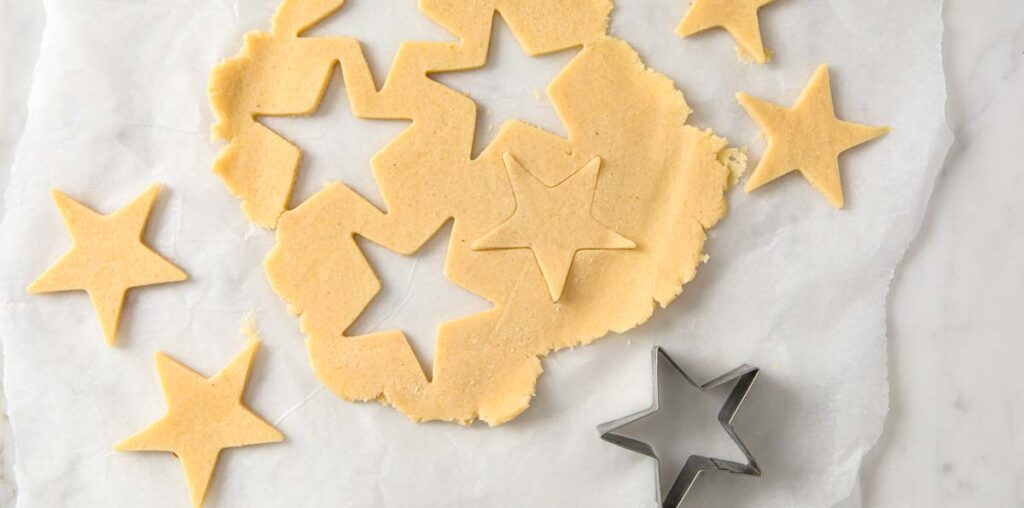 cutting out stars with a cookie cutter