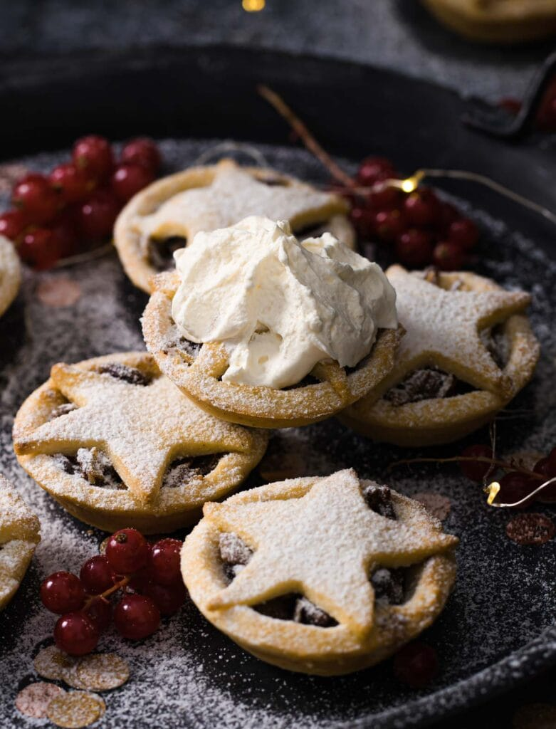 sugar free mince pies stacked, one topped with cream