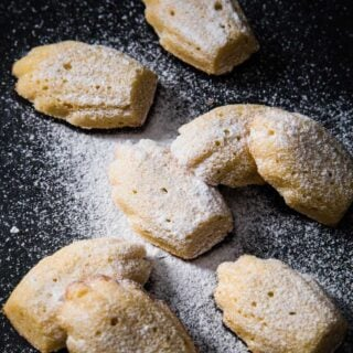 keto madeleines dusted with powdered sweetener