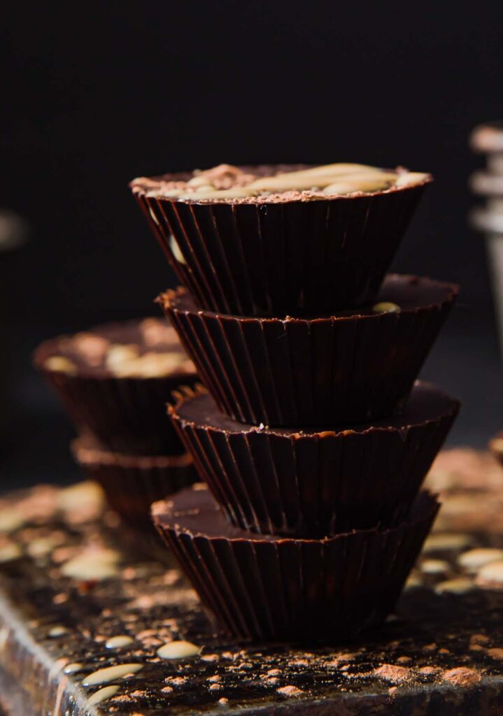 4 chocolate peanut butter cups stacked on top of each other