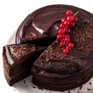 a chocolate sugar free birthday cake topped with chocolate ganache