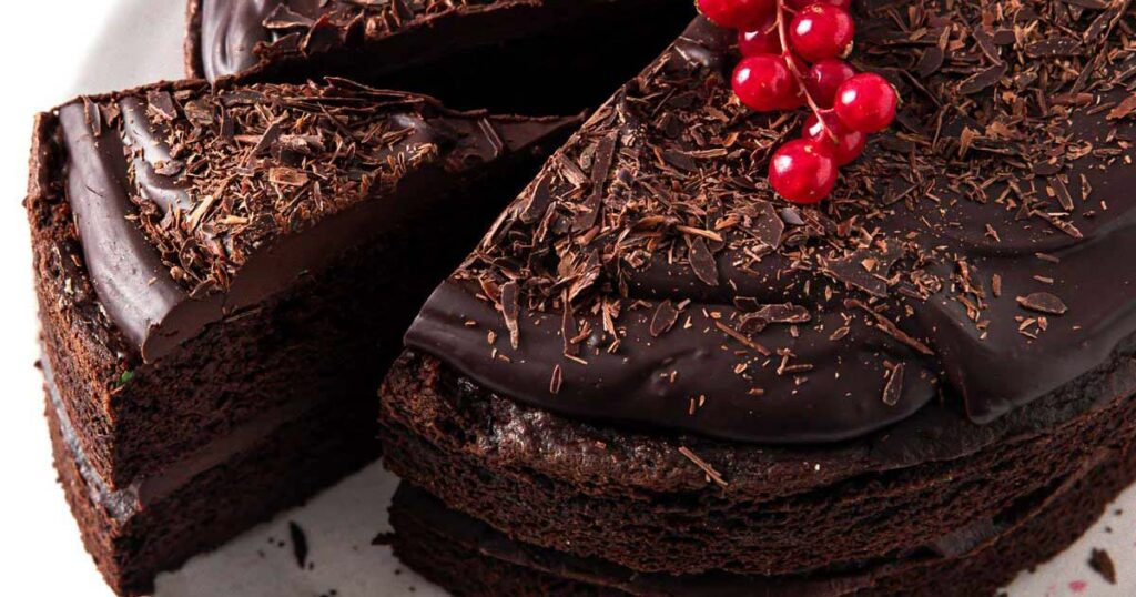 a slice of sugar free chocolate cake cut out from chocolate cake