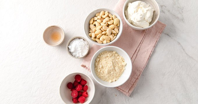 ingredients for cheesecake bites measured into bowls
