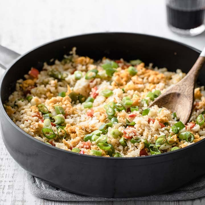 a pan with cauliflower fried rice