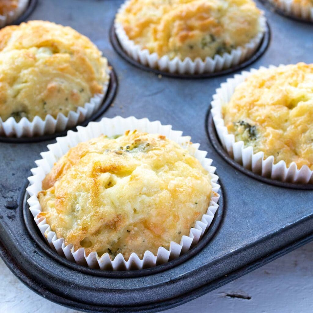 keto cheese muffins in paper cases in a muffin pan