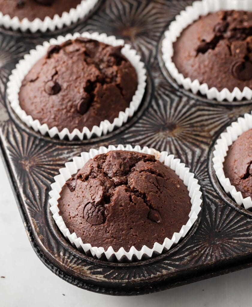 a muffin pan with keto chocolate chip muffins