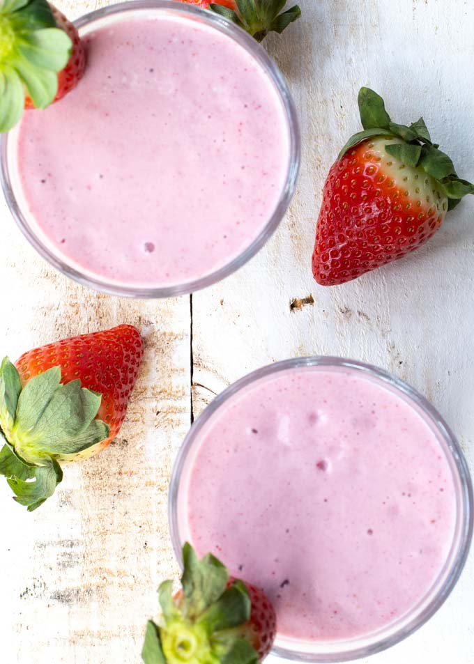 Overhead view of 2 strawberry smoothies