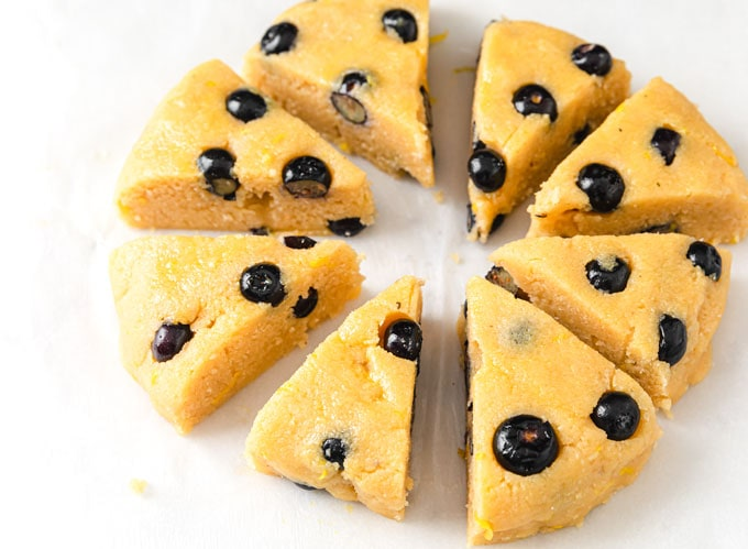 unbaked blueberry scone triangles on baking paper
