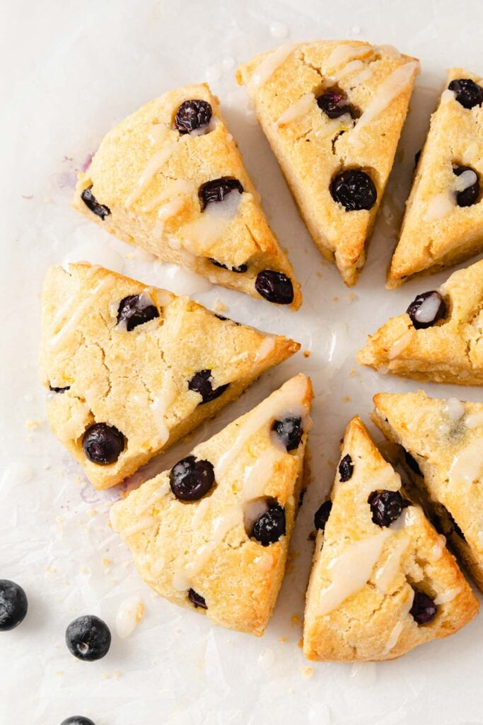 low carb blueberry scones arranged in a circle with lemon icing