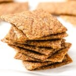 flaxseed crackers piled on top of each other into a stack