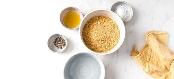 ingredients for flaxseed crackers measured into bowls