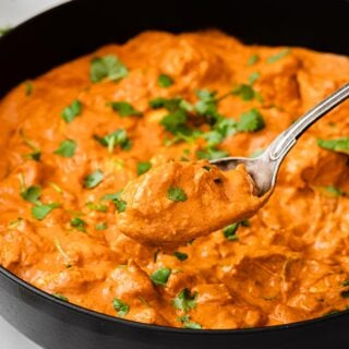keto chicken tikka masala in a pan and a spoon